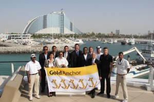 1. John Hogan, Superior, (centre) presenting Jumeirah Beach Hotel Marina management and staff with their 5 Gold Anchor accreditation