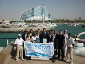 2.	John Hogan, Superior, (centre) presenting Jumeirah Beach Hotel Marina management and staff with their Clean Marina accreditation