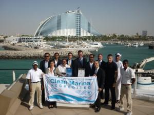 2.John Hogan, Superior, (centre) presenting Jumeirah Beach Hotel Marina management and staff with their Clean Marina accreditation